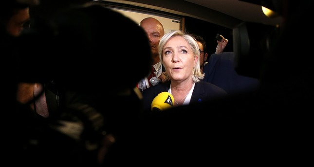 Far-right leader and candidate for next spring presidential elections Marine le Pen from France answers questions of journalists, in Germany, Saturday, Jan. 21, 2017. (AP Photo)