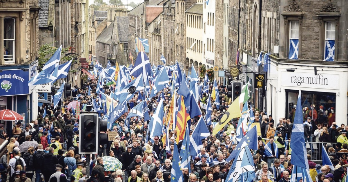 Pro-independence activists wave Scottish Saltire flags as they march from Holyrood to the Meadows in Edinburgh, Scotland, Oct. 5, 2019. (AFP Photo)