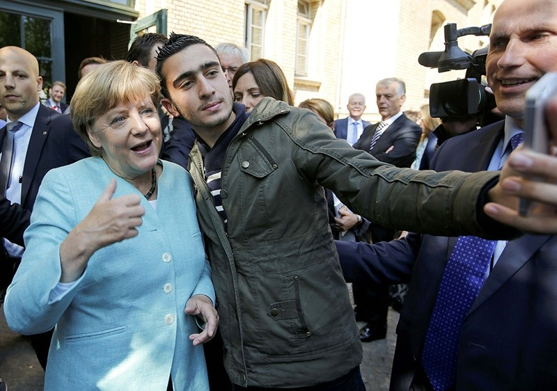 Anas Modamani takes a selfie with Angela Merkel in Berlin, in September 2015. (Reuters Photo)