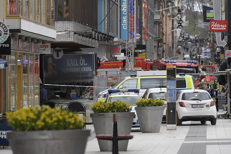 The rear of a truck, left, protrudes after it crashed into a department store injuring several people in central Stockholm, Sweden, Friday April 7, 2017. (AP Photo)