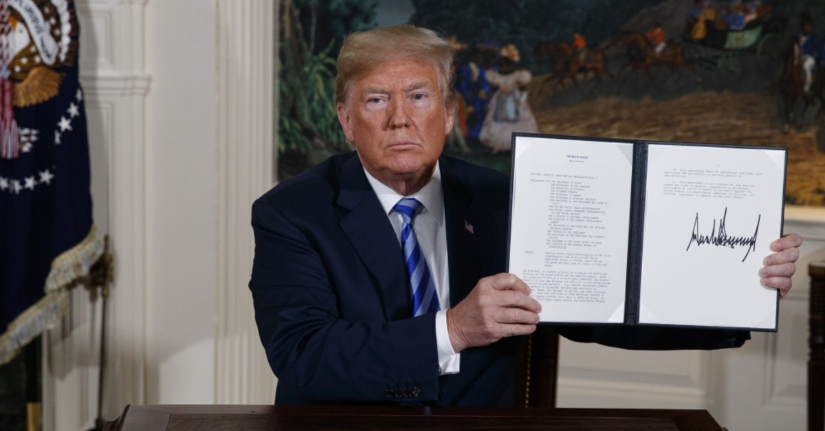 U.S. President Donald Trump shows a signed Presidential Memorandum at the White House, Washington, D.C., May 8, 2018.