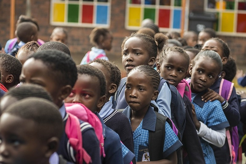 African students line up in front of their classrooms. (File Photo)