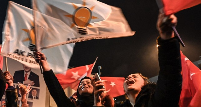 Supporters of the Justice and Development Party (AK Party) wave Turkish national and party flags as they celebrate local election results near AK Party headquarters in Istanbul, March 31, 2019.