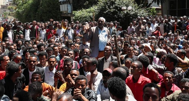 An Oromo elder chants slogans during a protest in-front of Jawar Mohammed's house, an Oromo activist and leader of the Oromo protest in Addis Ababa. (Reuters Photo)