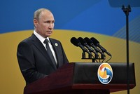 Russian President Vladimir Putin said on Monday that unlike the United States, his country does not supply weapons to the People's Protection Units (YPG) in Syria.