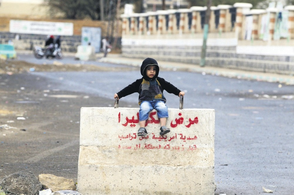A Yemeni child sits on a concrete barrier on a street in Sanaa, Yemen, April, 7.