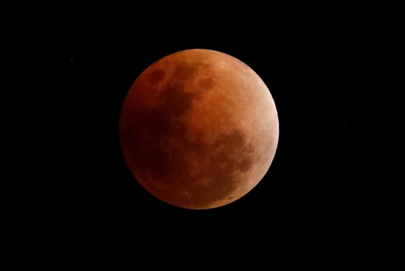 A so-called 'Super Blue Blood Moon' rises during a total lunar eclipse as seen from Quezon City, east of Manila, Philippines, 31 January 2018. (EPA Photo)
