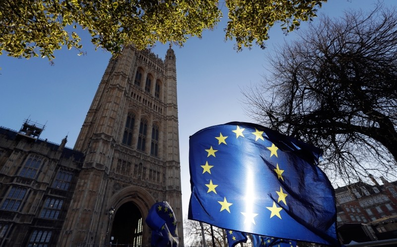 In this Jan. 22, 2019, file photo, the sun shines through European Union flags tied to railings outside parliament in London. (AP Photo)