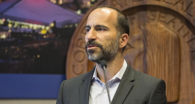 Expedia's CEO Dara Khosrowshahi announces his company is moving 3,000 employees from Bellevue, WA, to Seattle's waterfront in 2016, during a news conference in Seattle.