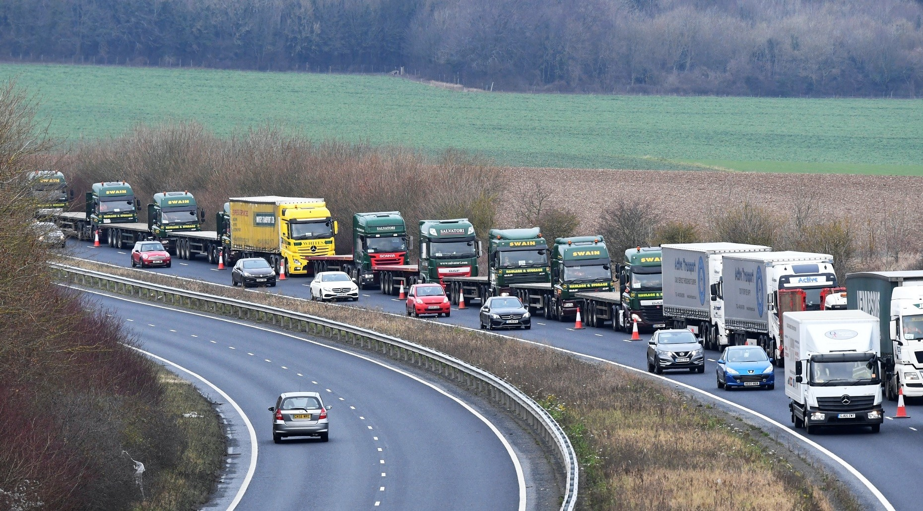 A line of trucks seen during a trial between the disused Manston Airport and the Port of Dover on how the road will cope in case of a u201cno-dealu201d Brexit in Kent, yesterday.
