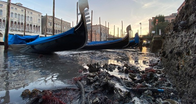 Gondolas are stranded in Venice, northern Italy, during exceptionally low tide, Thursday, Jan. 9, 2020. AP Photo