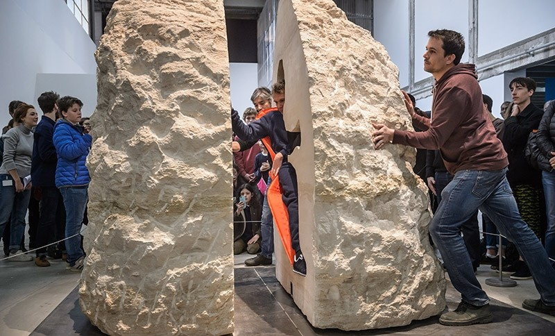 French artist Abraham Poincheval is locked up by his assistants to live inside a rock for a week, as part of an art performance entitled 'Pierre' (Stone) (EPA Photo)