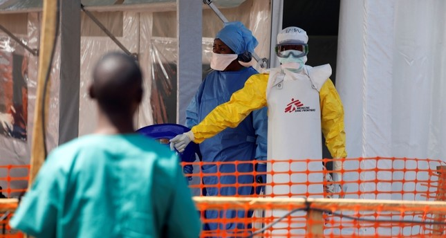 A health worker dressed in a protective suit talks to medical staff at the newly constructed MSF(Doctors Without Borders) Ebola treatment centre in Goma, Democratic Republic of Congo, August 4, 2019. (REUTERS Photo)