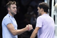 Flustered Federer botches shot as Sock turns backside
