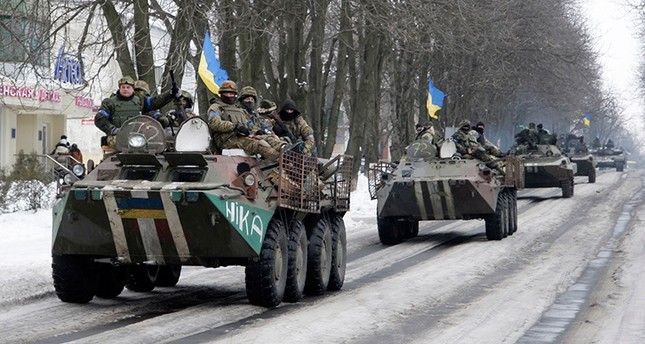 Members of the Ukrainian armed forces drive armored vehicles in the town of Volnovakha, eastern Ukraine, January 18, 2015. Reuters Photo
