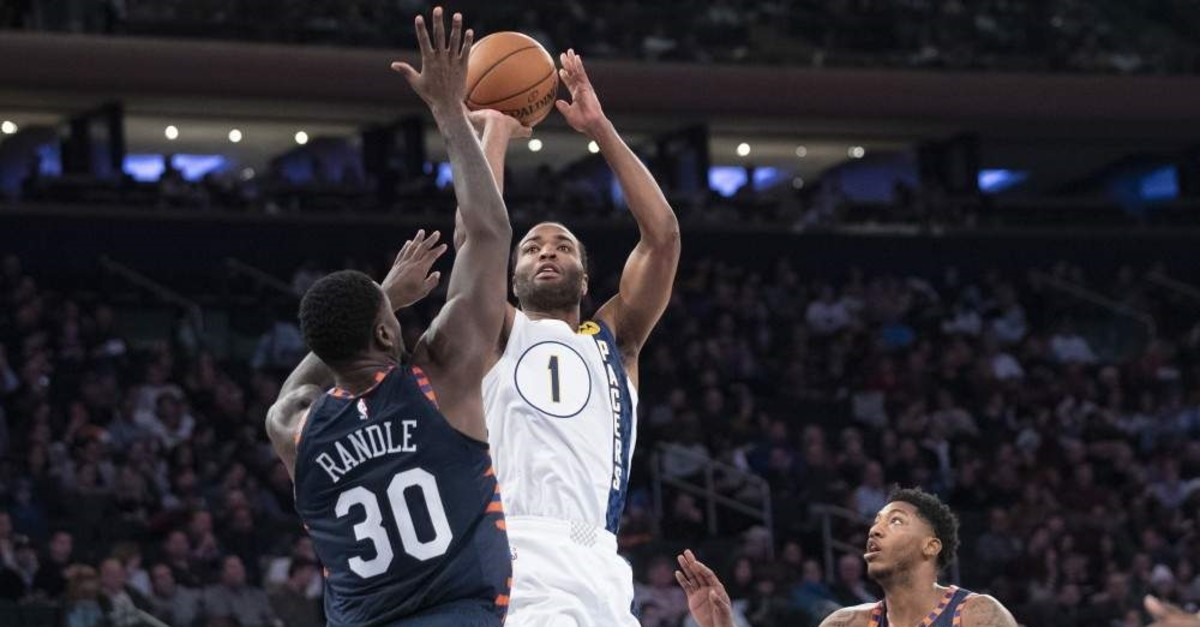 Indiana Pacers' T.J. Warren (R) goes to the basket against the New York Knicks' Julius Randle (L), New York, Dec. 7, 2019. (AP Photo)
