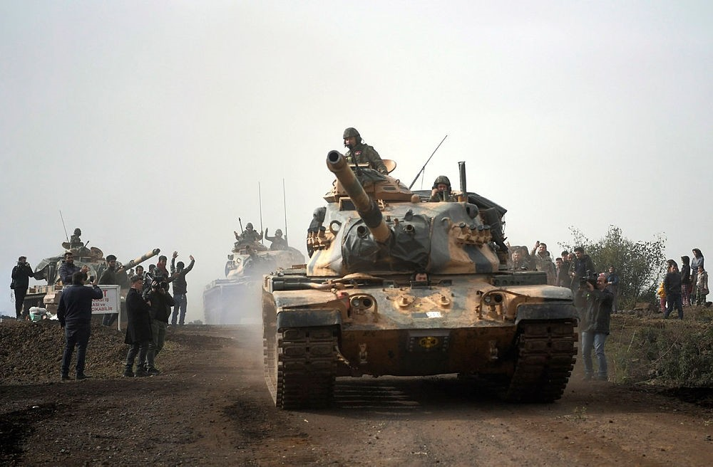 Turkish tanks enter Afrin, an enclave in northern Syria controlled by YPG, in Hassa, Hatay, Turkey, Monday, Jan. 22, 2018.(AP Photo)