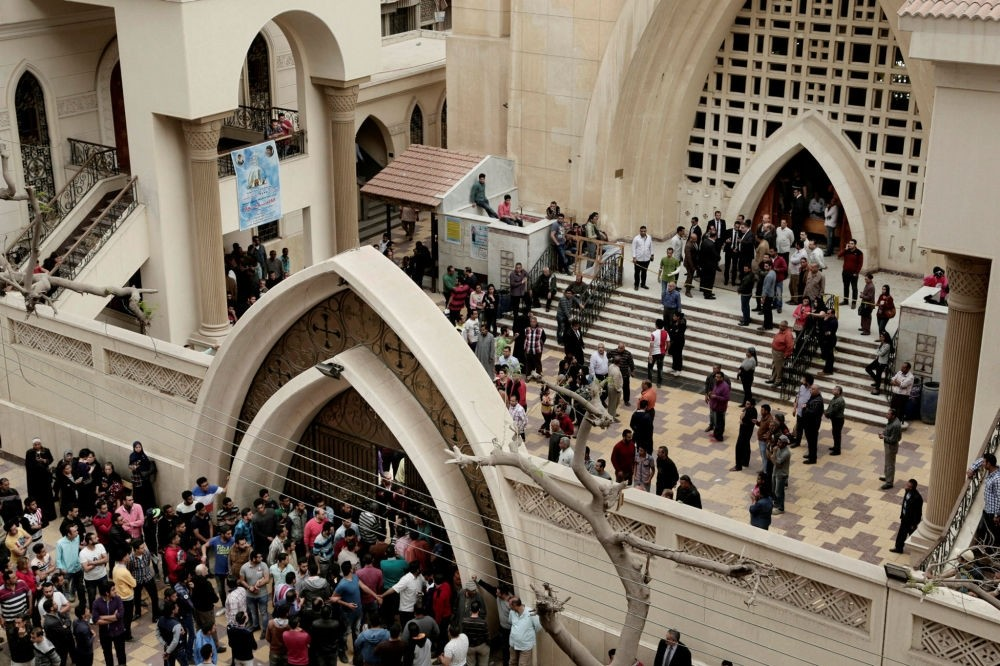 People gather outside St. George's Church after a deadly suicide bombing in the Nile Delta town of Tanta, Egypt, April 9.