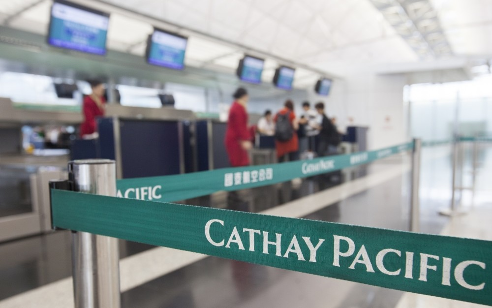 Flight attendants from Hong Kong's flag carrier airline Cathay Pacific are seen at Hong Kong International Airport, Lantau Island, Hong Kong.