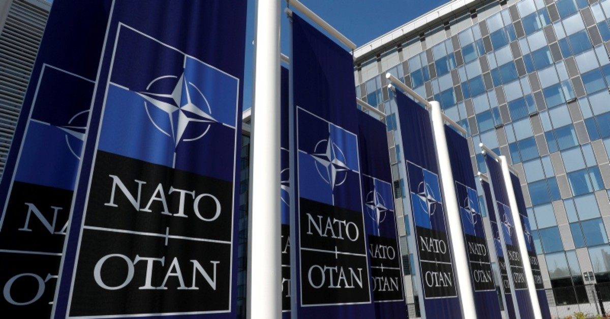 Banners displaying the NATO logo are placed at the entrance of new NATO headquarters during the move to the new building, in Brussels, Belgium April 19, 2018. (Reuters File Photo)