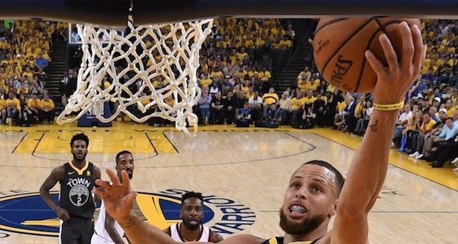 Golden State sharpshooter Stephen Curry delivered a performance for the ages Sunday with an NBA Finals record nine 3-pointers powering the defending champion Warriors over LeBron James and the Cleveland Cavaliers.