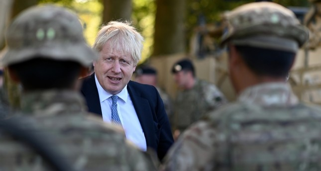 Britain's Prime Minister Boris Johnson chats with Ghurkas during a visit to military personnel on Salisbury plain training area near Salisbury, Britain September 19, 2019. Reuters Photo
