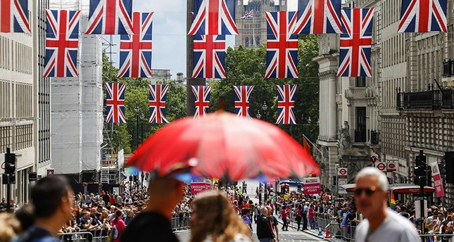 Union flag banners hang across a street near the Houses of Parliament in central London on June 25, 2016 (AFP)
