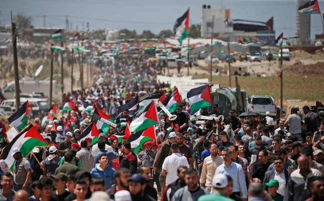Palestinian demonstrators gather east of Gaza City in the Gaza Strip, May 15, 2019, during a protest marking the 71th anniversary of Nakba — also known as Day of the Catastrophe in 1948.