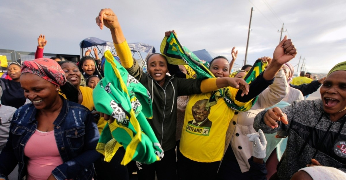 African National Congress supporters celebrate outside a voting station in Khayelitsha Township, Cape Town, South Africa, Wednesday, May 08, 2019. (AP Photo)