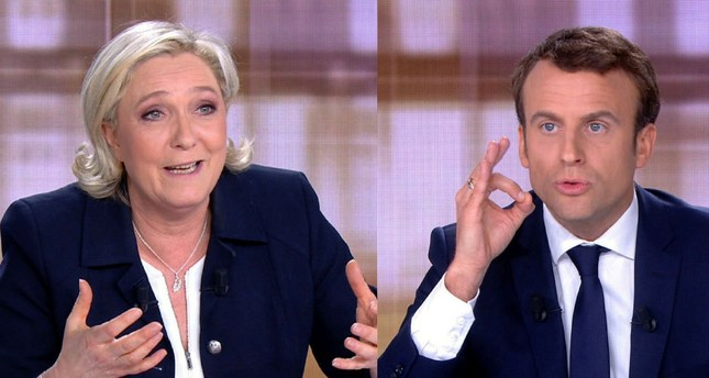 French President Emmanuel Macron and far-right leader Marine Le Pen face off in a final televised debate, May 3, 2017.