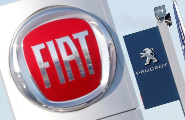 The logos of car manufacturers Fiat and Peugeot are seen in front of dealerships of the companies in Saint-Nazaire, France, Nov. 8, 2019. Reuters Photo