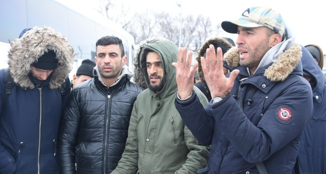 Palestinian migrant Qasim Amin R, accompanied by other migrants, tells reporters their plight on the Greek side of the border.