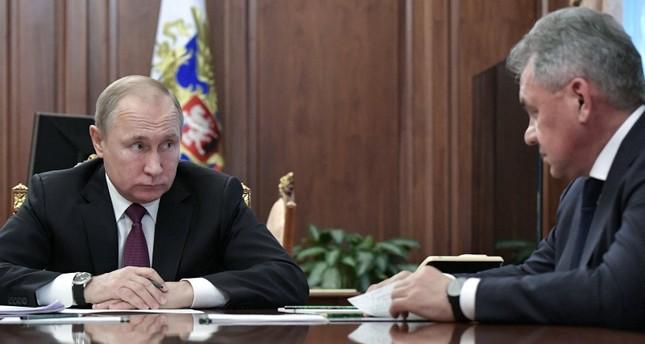 Russia's President Vladimir Putin meets with Defense Minister Sergei Shoigu at the Kremlin in Moscow, Russia, Feb. 2, 2019. (Kremlin via Reuters)