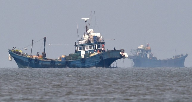 A handout picture made available by the by South Korean Defense Ministry, shows Chinese illegal fishing boats are seen in neutral waters near the inter-Korean, At Sea (EPA Photo)