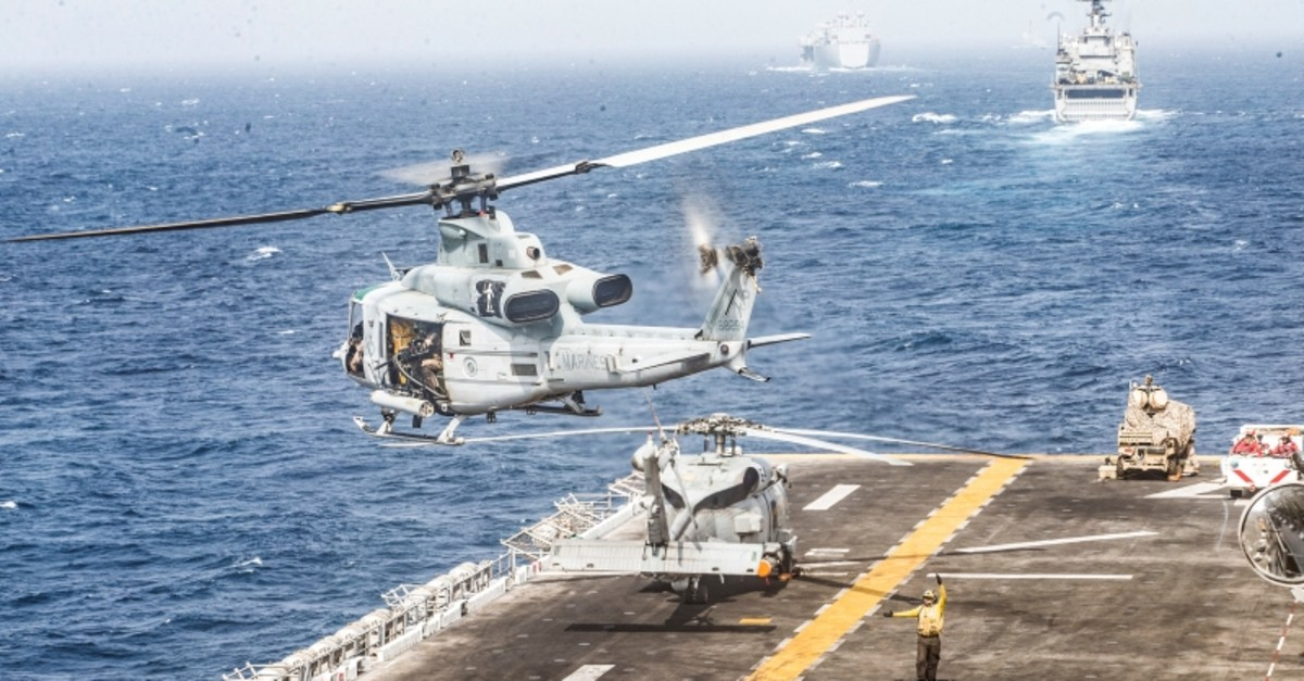 A UH-1Y Venom helicopter with Marine Medium Tiltrotor Squadron (VMM) 163, 11th Marine Expeditionary Unit (MEU), takes off from the flight deck of USS Boxer (LHD 4) during its transit through Strait of Hormuz, July 18, 2019. (REUTERS Photo)