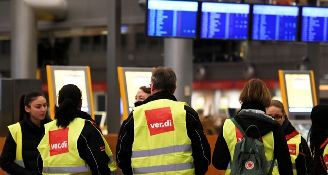 Members of German union Verdi demonstrate at the Helmut Schmidt airport during a strike of security personnel demanding higher wages in Hamburg (Reuters Photo)