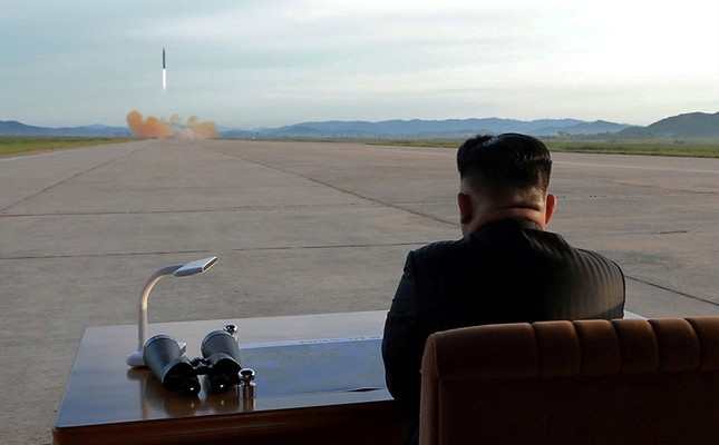 North Korean leader Kim Jong Un watches the launch of a Hwasong-12 missile in this undated photo released by North Korea's Korean Central News Agency (KCNA), Sept. 16, 2017. (via Reuters)