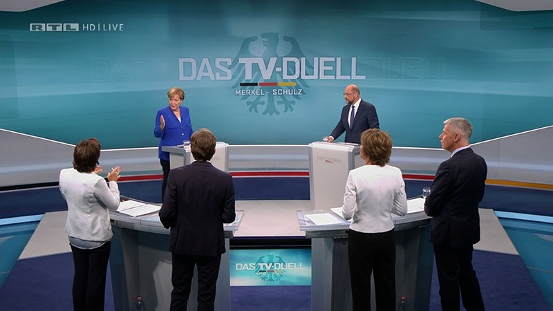 A screen that shows the TV debate between German Chancellor Angela Merkel of CDU and her challenger SPD candidate for chancellor Martin Schulz in Berlin, Germany, Sept. 3, 2017. (Mediengruppe RTL Deutschland (MG RTL D) via Reuters)