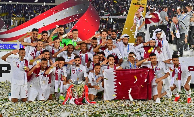 Players and teammembers of Qatar celebrate with trophy after winning the AFC Asian Cup final match between Japan and Qatar in Zayed Sport City in Abu Dhabi, United Arab Emirates, Friday, Feb. 1, 2019. (AP Photo)