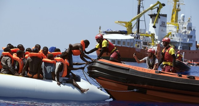 Rescuers from NGO Open Arms conduct a rescue operation in the waters some 25 Nautical miles (29 miles, 46 kilometers) north of the Libyan coast. AP Photo