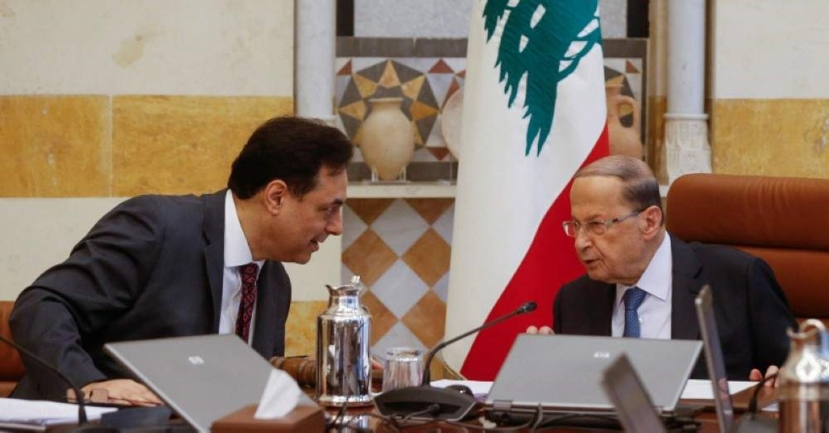 Lebanon's Prime Minister Hassan Diab speaks with Lebanon's President Michel Aoun during a cabinet meeting at the presidential palace in Baabda, Lebanon Feb. 6, 2020. (Reuters Photo)