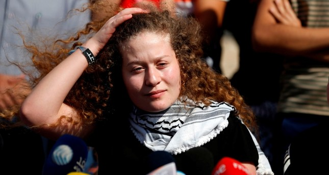 Palestinian activist and campaigner Ahed Tamimi speaks during a press conference on the outskirts of the West Bank village of Nabi Saleh on July 29, 2018, upon her release from prison after an eight-month sentence. (AFP Photo)