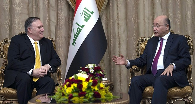US Secretary of State Mike Pompeo, left, meets with Iraqi President Barham Salih, in Baghdad, Iraq, Wednesday, Jan. 9, 2019. (AP Photo)