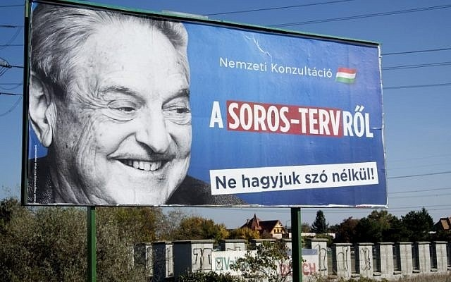 A billboard with a poster of Hungarian-American billionaire and philanthropist George Soros with the words 'National consultation about the Soros plan - Don't let it pass without any words' is seen in Budapest on October 16, 2017. (AFP Photo)