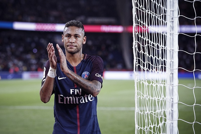 PSG's Neymar applauds with supporters after the French League One soccer match between PSG and Toulouse at the Parc des Princes stadium in Paris, Aug. 20, 2017. (AP Photo)