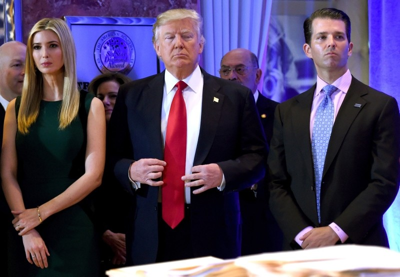 In this file photo taken on January 11, 2017, US President-elect Donald Trump (C) stands with his children Ivanka (L) and Donald Jr., during Trump's press conference at Trump Tower in New York. (AFP Photo)