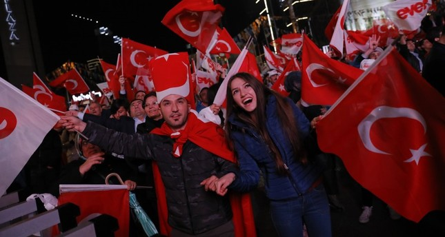 Supporters of the 'yes' camp celebrate as the results of the constitutional referendum are announced in Ankara, April 16.
