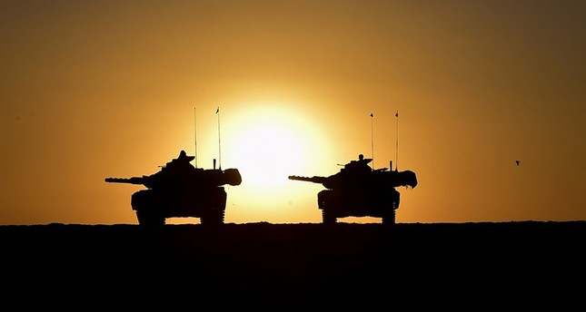 A handout photo made available by the Turkish General Staff press office shows Turkish soldiers with their tanks participate in a military exercise near the Turkish-Iraqi border in the Silopi district, in Şırnak, Turkey, September 29 2017 (EPA Photo)