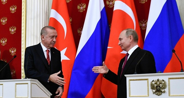 President Recep Tayyip Erdoğan, left, and Russian President Vladimir Putin prepare to shake hands after their joint news conference following the talks in the Kremlin in Moscow, Russia, Wednesday, Jan. 23, 2019. Pool Photo via AP
