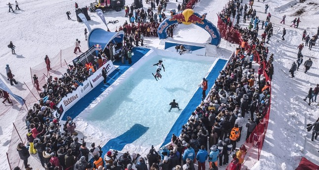 The participants of Red Bull Jump & Freeze will slide down the 50-meter slope into freezing water.